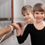 Girl and Boy at Ballet Barre