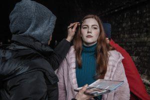 Sophie Jane Oliver having make up applied for film Shortcut
