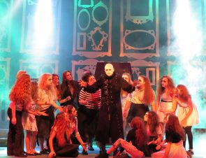 Alex Murphy as Uncle Fester in The Addams Family